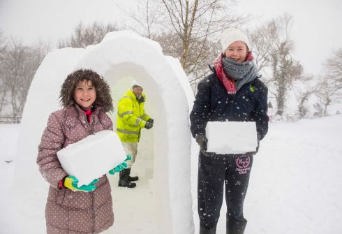 Kyra and Makenzie Molloy with their igloo at Foulksmills, Co. Wexford.  Photograph: Patrick Browne