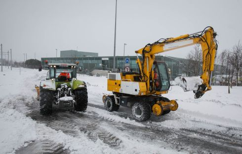 JCB's removing snow at the Red Cow Luas Station in blizzard conditions following storm Emma on the Naas Rd  Dublin.   Photograph: Gareth Chaney / Collins