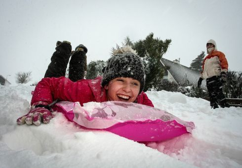 Sadhbh Murphy makes the most of the snowfall as she slides down the hill on a lilo in Lamberton, Arklow, Co Wicklow. Photograph: Garry O'Neill