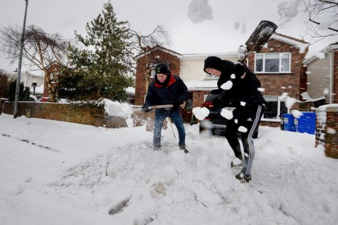 John Finnerty and John Finnerty Junior clearing snow from their driveway in Dunboyne Co. Meath.  Photograph: Alan Betson / The Irish Times