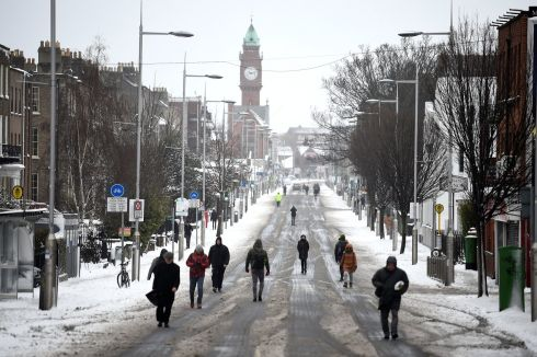 Commuters walk on the main road at Rathmines after all public transport was cancelled, due to adverse weather conditions in Dublin. Photograph: Clodagh Kilcoyne / Reuters