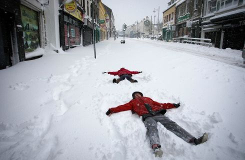 James and Gemma Kavanagh practice their Snow angels on Main street, Arklow, Co Wicklow. Photograph: Garry O'Neill