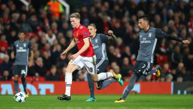 Scott McTominay the young Manchester United player breaks free from Andreas Samaris of Benfica in October 2017