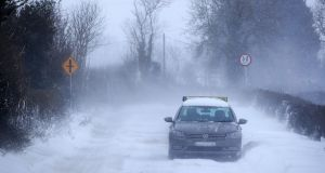 A taxi on the Clonee Road  just prior to a level Red snow/blizzard warning on Thursday. Photograph: Colin Keegan, Collins.