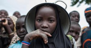 Extremism in Africa: a girl at a camp for internally displaced people in northern Nigeria, where Boko Haram declared a caliphate in 2014. Photograph: Stefan Heunis/AFP/Getty