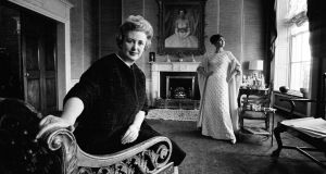 "Irish fashion designer Sybil Connolly at her Dublin fashion house in 1965. The key to entertaining was ""staff"", she said. Photograph: Getty Images"