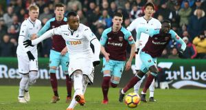 Jordan Ayew of Swansea City scores his side's fourth goal from the penalty spot during the Premier League match between Swansea City and West Ham United at Liberty Stadium. Photo: Jan Kruger/Getty Images