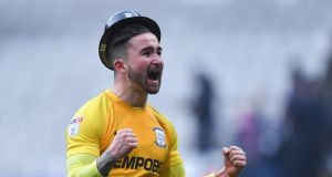 Preston North End's Sean Maguire celebrates victory whilst wearing a bowler hat for Gentry Day at the final whistle of the Sky Bet Championship match between Bolton and Preston at the Macron Stadium, Bolton. Photo: Dave Howarth/PA Wire