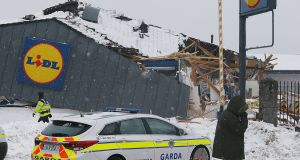 Gardaí preserve the scene at the Lidl store in Fortunestown Lane,Tallaght. Photograph: Stephen Collins/ Photos