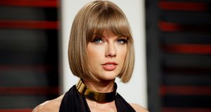 "Taylor Swift:  ""I don't see how that would work,"" said a frowning 22-year-old about office music. ""Listening to Taylor Swift all day would be very grim"""