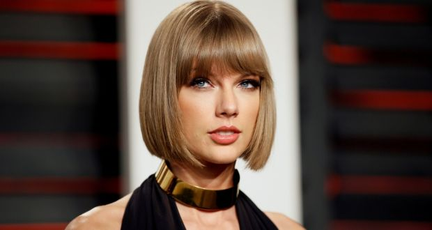 """Taylor Swift:  """"I don't see how that would work,"""" said a frowning 22-year-old about office music. """"Listening to Taylor Swift all day would be very grim"""""""