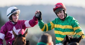 Jockey Derek O'Connor (right) is congratulated by Jack Kennedy after winning the Irish Gold Cup with Edwulf. Photograph: Morgan Treacy/Inpho