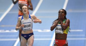 Ethiopia's Genzebe Dibaba  celebrates winning n the Women's 1500 metres final ahead of Scotland's Laura Muir during the IAAF Athletics World Indoor Championships at Birmingham. Photograph: Facundo Arrizabalaga/EPA
