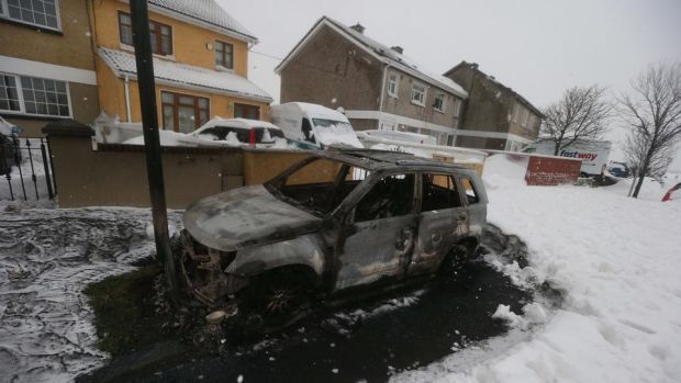 Burnt-out car: at least eight vehicles were set alight after the Lidl looting. Photograph: Stephen Collins/Collins