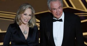 Faye Dunaway and Warren Beatty present the Oscar for Best Film during the 90th Annual Academy Awards show on March 4, 2018 in Hollywood, California.  Photograph: Mark Ralston, Getty Images