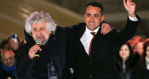 Five Star Movement founder Beppe Grillo (L) speaks next to leader Luigi Di Maio during the finally rally ahead of the March 4th elections in downtown Rome. Photograph: Tony Gentile