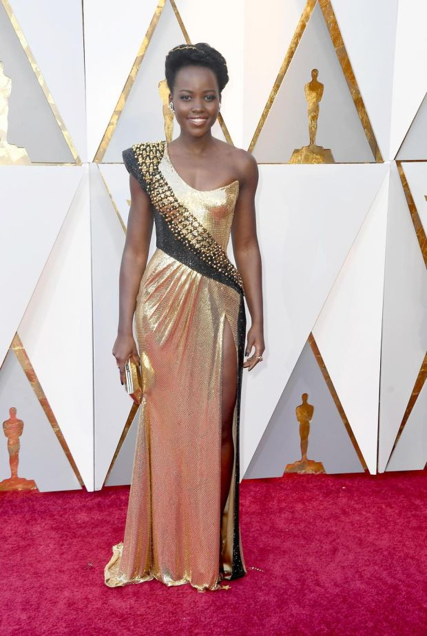 Lupita Nyong'o was resplendent in a liquid gold one-shoulder gown