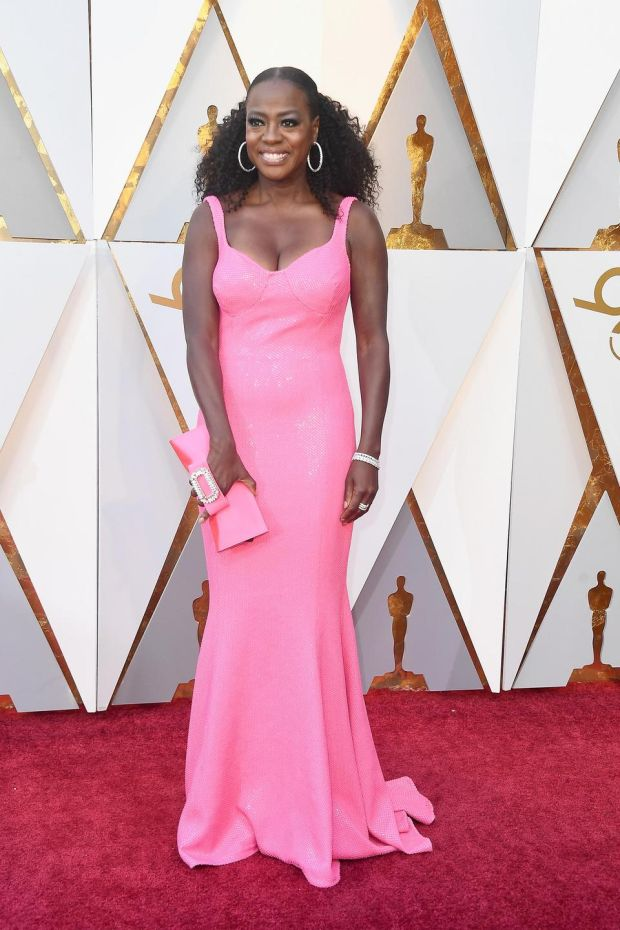 Viola Davis picked a hot pink shade gown coordinating with a matching clutch in the same colour family