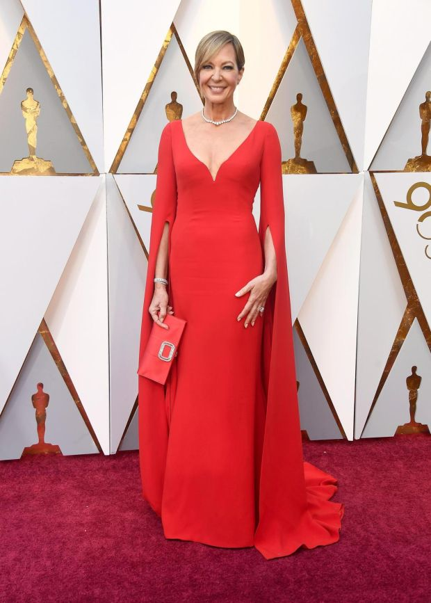 Allison Janney wore a vibrant rouge Reem Acra dress with plunging décolletage and cape sleeves