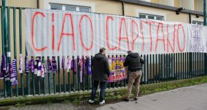 Fiorentina fans put up scarves, flowers and banners in memory of their captain Davide Astori. Photograph: PA