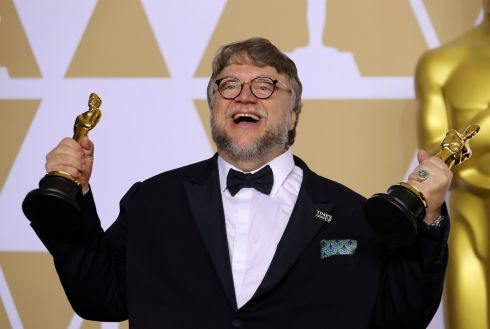 "90th Academy Awards - Oscars Backstage -  - Guillermo del Toro with the Best Director Award and the Best Picture Award for ""The Shape of Water"". Photograph: Mike Blake /Reuters"
