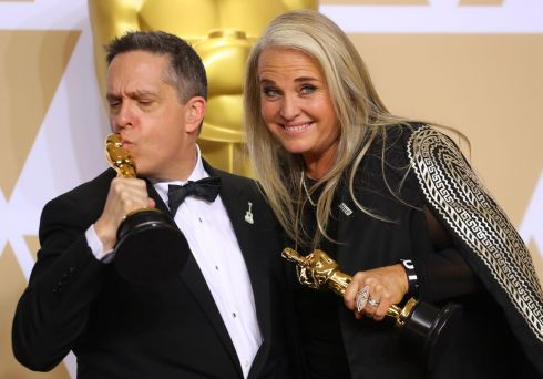 "90th Academy Awards - Oscars Backstage - - Lee Unkrich (L) and Darla K. Anderson hold their Oscars for Best Animated Feature Film ""Coco"".  Photograph: Mike Blake /Reuters"