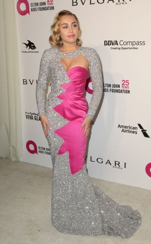 Miley Cyrus arrives at the 2018 Elton John AIDS Foundation Oscar Viewing Party .  Photograph:  Willy Sanjuan/Invision/AP