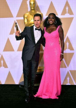 Sam Rockwell and Viola Davis pose in the press room with the Oscar for Actor in Supporting Role Photograph: Frederick Brown / Getty