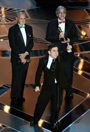 "Sound mixer Gary A. Rizzo (C) delivers a speech flanked by sound mixers Gregg Landaker (L) and Mark Weingarten after they won the Oscar for Best Sound Mixing for ""Dunkirk"" . Photograph: Mark Ralston / AFP"