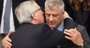 European Commission president Jean-Claude Juncker (left) kisses president of Kosovo Hashim Thaci during a tour of Balkan states last week. Photograph: Vassil Donev/EPA