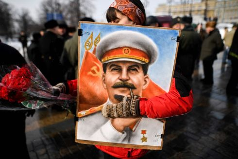 Russian Communist party supporters attend a memorial ceremony on Red Square in Moscow to mark the 65th anniversary of Soviet leader Joseph Stalin's death. Photograph: Kirill Kudryavtsev/AFP/Getty Images