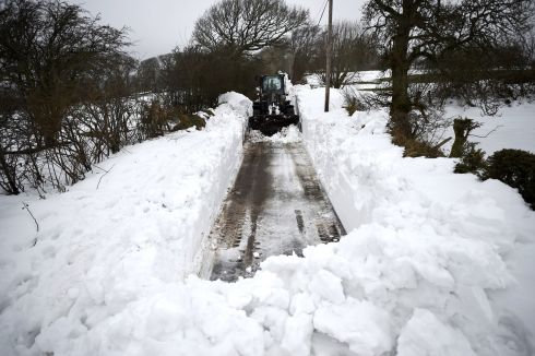 Army Private Patrick Macken clears snow to open up a path to Thomas Jones's farm in Blessington, Wicklow. Photograph: Clodagh Kilcoyne/Reuters