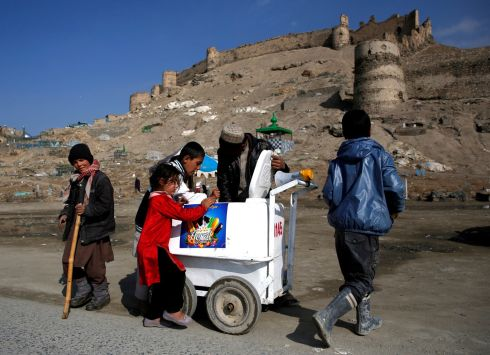 Children buy ice cream in Kabul, Afghanistan. Photograph: Mohammad Ismail/Reuters