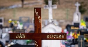 A cross stands on the grave of murdered journalist Jan Kuciak – who was slain as he was about to publish an explosive report on alleged high-level corruption linked to the Italian mafia –  prior to his funeral at a cemetery in Stiavnik, Slovakia, last Saturday. Photograph: Vladimir Simicek/AFP/Getty Images