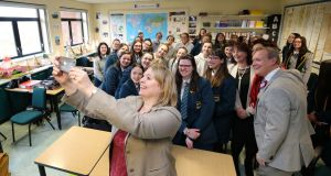 Northern Ireland secretary Karen Bradley with pupils and staff during a visit to Thornhill College in Derry. Photograph: Kelvin Boyes/Press Eye/PA