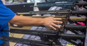 Rows of AR-15 style rifles on display at the Florida Gun Show in Tampa, Florida. Photograph: Zack Wittman/The New York Times