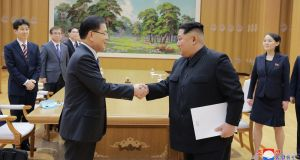 North Korean leader Kim Jong-un shakes hands with South Korean national security director Chung Eui-yong, in Pyongyang, North Korea. Photograph: Korea News Service via AP