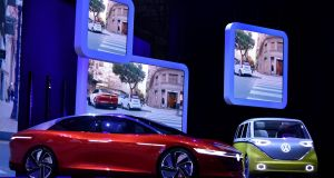 The new Volkswagen I.D. Vizzion (left is makes its world debut at the Geneva motor show