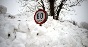 A road sign is seen submerged in deep snow in Kilteel, Co Kildare. Photograph: Reuters