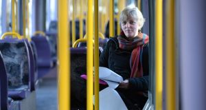 Ann Hayes, who studies on her commute into work, is one of a rising number of employees who are upskilling through remote learning.  Photo: Dara Mac Dónaill