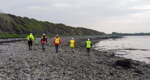 The  Oranmore Maree Coastal Search Unit combing the shore for clues  on the shore in Galway Bay. Photograph: Sean Green, OMCSU