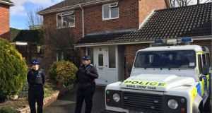 Police officers stand outside the Salisbury home of former Russian double agent Sergei Skripal, after he and and a woman in her 30s were found slumped on a bench  in Salisbury on Sunday. Photograph: Ben Mitchell/PA Wire