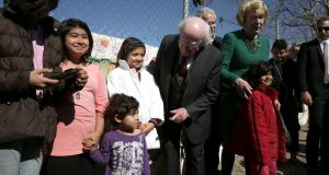President Michael D Higgins and  Sabina Higgins visit a refugee camp in Athens, Greece, in February. The Irish Refugee Council, Nasc and Oxfam Ireland are calling on the Government to expand the definition of family within the International Protection Act 2015. Photograph: Simela Pantzartzi/EPA