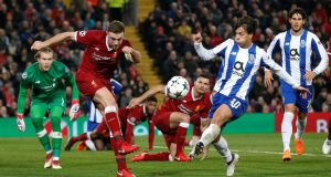 Jordan Henderson hacks the ball clear against Porto. Photograph: Andrew Yates/Reuters