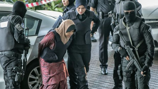 Siti Aisyah of Indonesia, who is being detained in connection with the death of Kim Jong-Nam, is escorted by Malaysian police officers as she arrives at the Shah Alam High Court, in Shah Alam, Malaysia, 27 February 2018. Photograph: EPA/AHMAD YUSNI