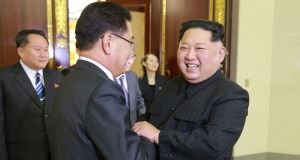 A photograph  released by  North Korea's official Korean Central News Agency  shows North Korean leader Kim Jong-Un (right) shaking hands with South Korean envoy  Chung Eui-yong ,  during their meeting in Pyongyang.