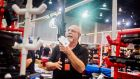 Scott Rollf, a seller at the  Florida Gun Show. Rollf says he approves of raising the age minimum and is fine with banning bump stocks and other attachments that boost firing speeds. Photograph: Zack Wittman/The New York Times