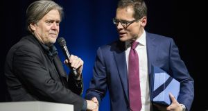 "Former White House strategist Steve Bannon shakes hands with the editor of Swiss weekly Weltwoche (World week), Roger Koeppel during an  event in Zurich. Asked about his relationship with Trump, Bannon was gushing: ""I love the guy and he's done a great job."" Photograph: EPA"