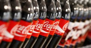 "From April 6th, ""take-home"" Classic Coke bottles are shrinking to 1.5l to take the edge off the effects of the sugar tax. Photograph: SeongJoon Cho/Bloomberg"