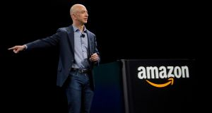 Jeff Bezos, chief executive officer of Amazon.com: has a personal net worth of approximately $127 billion, the collective value of 2.3 million Americans.  Photograph: Mike Kane/Bloomberg